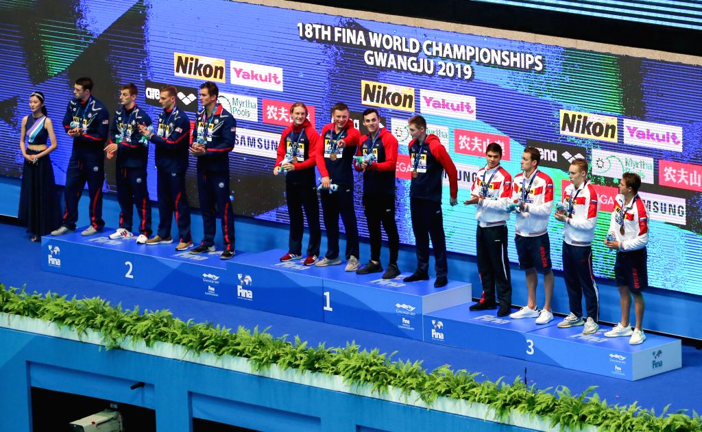 GWANGJU, July 28, 2019 - Silver medalists, swimmers of the United States, gold medalists, swimmers of Britain and bronze medalists, swimmers of Russia (L to R) pose during the awarding ceremony of ...