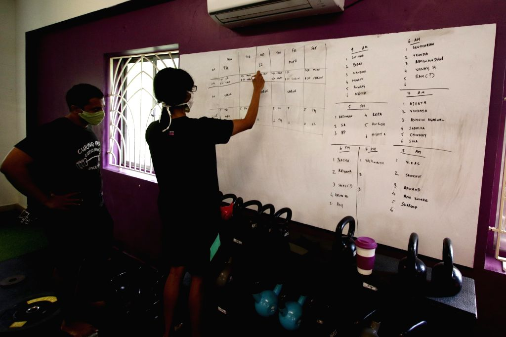 Gym instructors marking the schedule of their customers to follow the guidelines issued by the Government, as it gears up to re-open amid COVID-19 pandemic in Chennai on Aug 6, 2020.