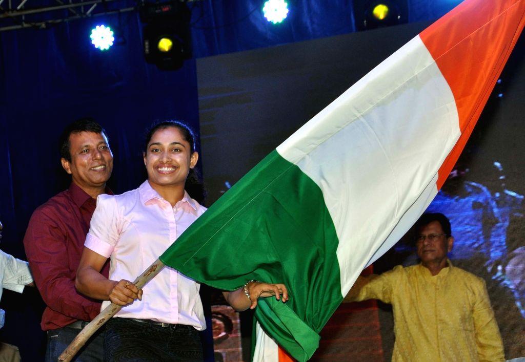 Gymnast Dipa Karmakar and her coach  Bisheshwar Nandi during a programme organised to felicitate her  in Kolkata, on Sept 18, 2016.