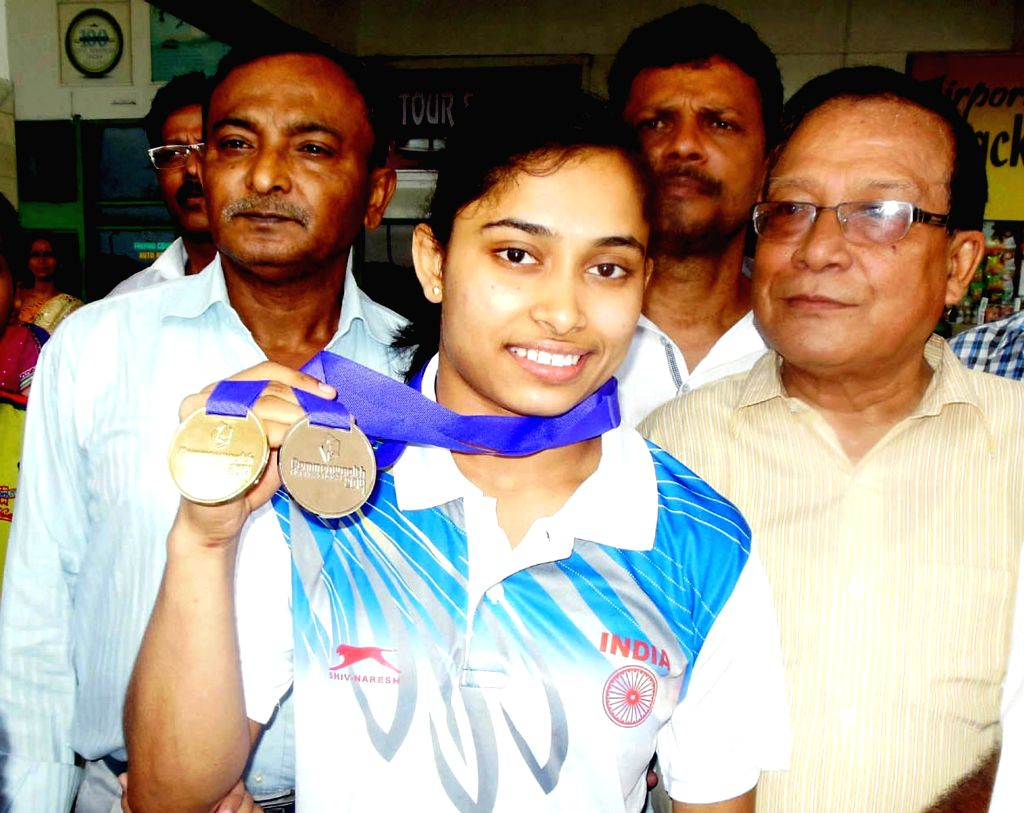 Gymnast Dipa Karmakar at Agartala airport after returning from International Commonwealth Championships in Perth, Scotland where she won a a gold and a silver medal in the women's vault and women's ..