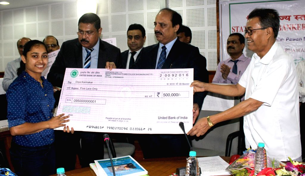 Gymnast Dipa Karmakar being felicitated during the 118th meeting State Level Bankers' Committee (SLBC) of Tripura in Agartala on Sept 20, 2016. Also seen Tripura Finance Minister Bhanu Lal ... - Bhanu Lal Saha