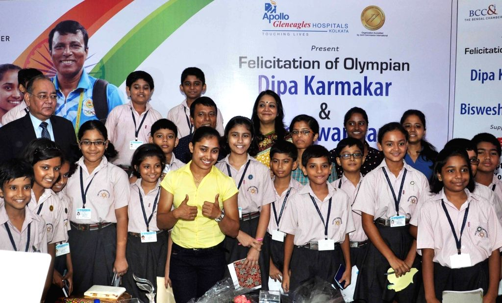 Gymnast Dipa Karmakar with her coach Bisheswar Nandi during a felicitation programme organised by The Bengal Chamber of Commerce and Industry in Kolkata on Sept 19, 2016.