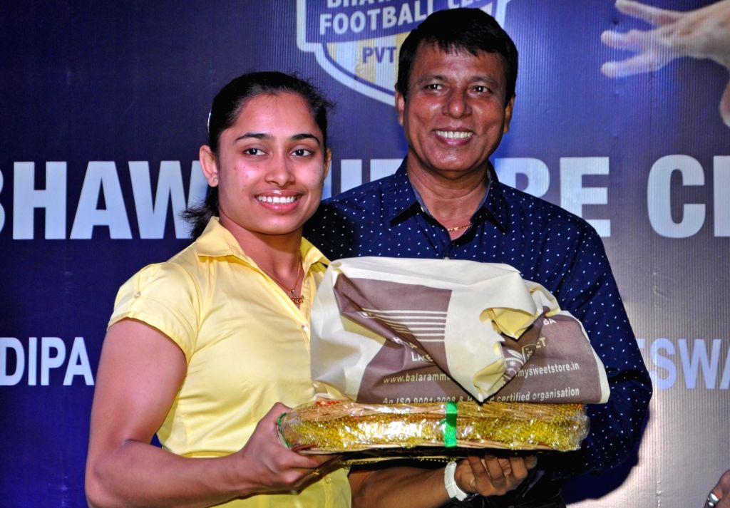 Gymnast Dipa Karmakar with her coach Bisheswar Nandi during a felicitation programme organised by Bhawanipore Club in Kolkata on Sept 19, 2016.