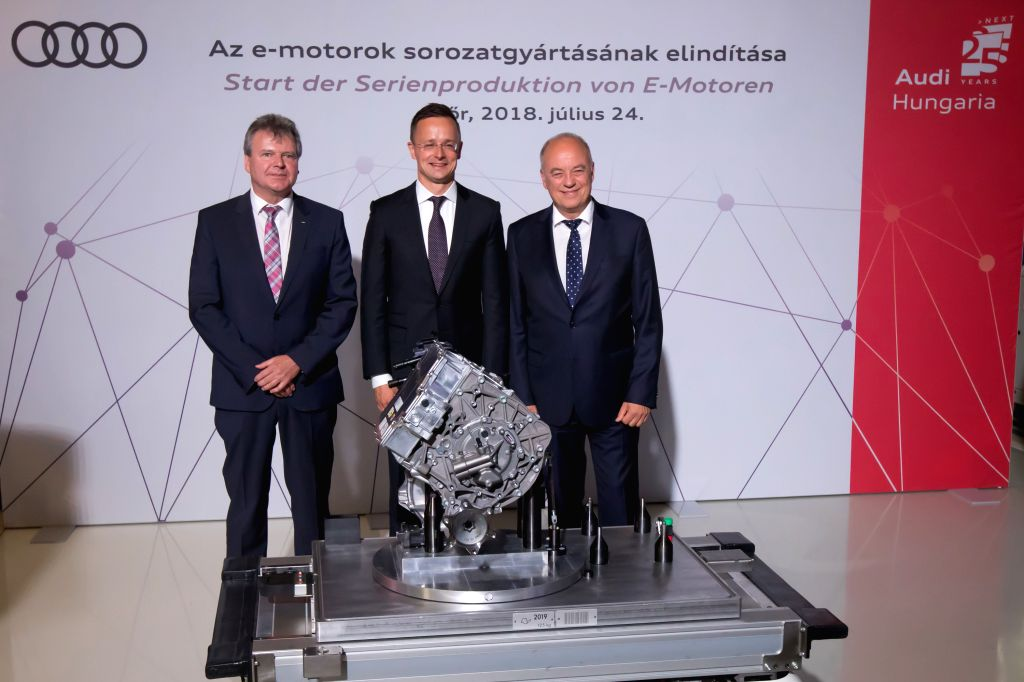GYOR, July 25, 2018 - Achim Heinfling (L), Chairman of the Audi Hungaria board of management, Hungary's Minister of Foreign Affairs and Trade Peter Szijjarto (C) and Audi board of management member ...