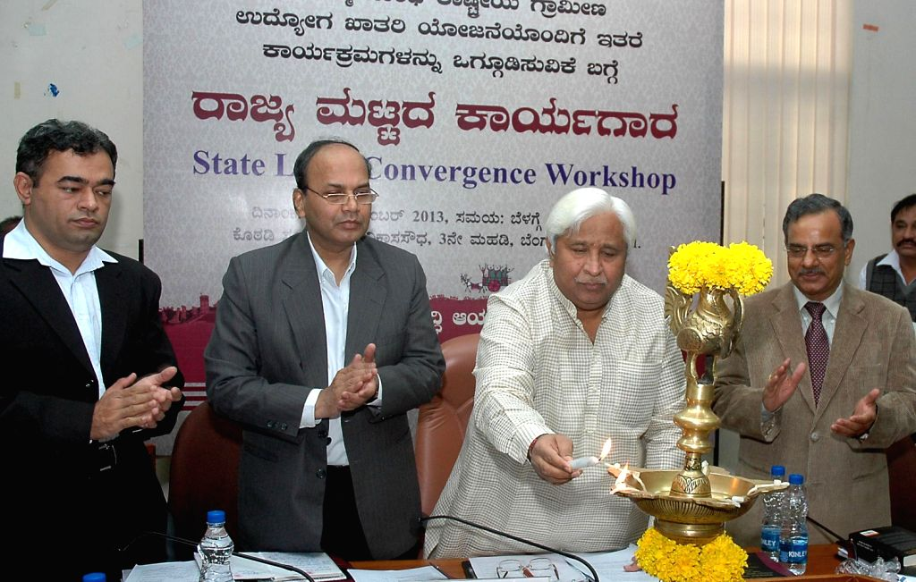 H K Patil Minister for RDPR who inaugurated the State Level Convergence Workshop for field officers also seen are Viajay Bhaskar, Principal Secretary, RDPR and G K Raju, Secretary, RDPR, organized by