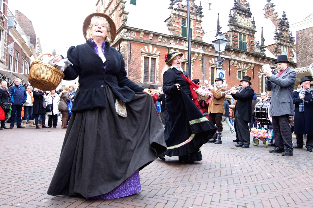 People dressed in old style costumes perform at the traditional Christmas Market in Haarlem, Dec. 13, 2014. Haarlem, a city in the west of the Netherlands, went ...