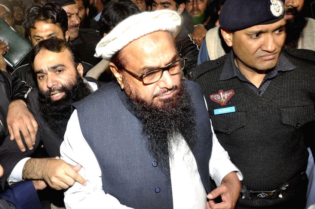Hafiz Saeed (C). (Xinhua/Sajjad/IANS) (lrz)
