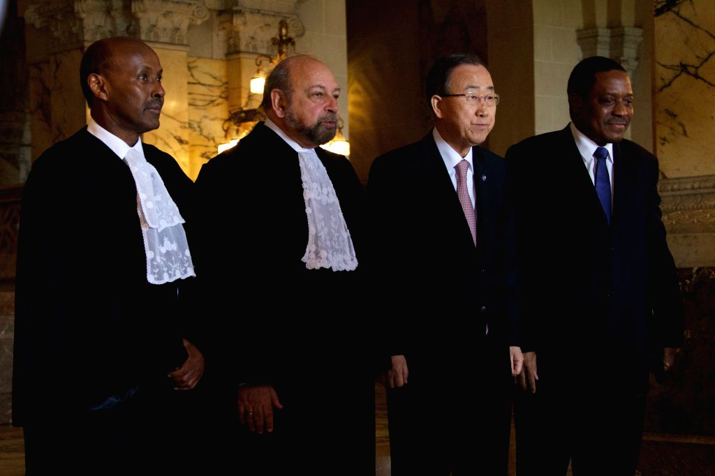 HAGUE, April 20, 2016 - (From left to right) Vice-President of the International Court of Justice (ICJ) Abdulqawi Ahmed Yusuf, President of ICJ Ronny Abraham, UN Secretary-General Ban Ki moon, and ...