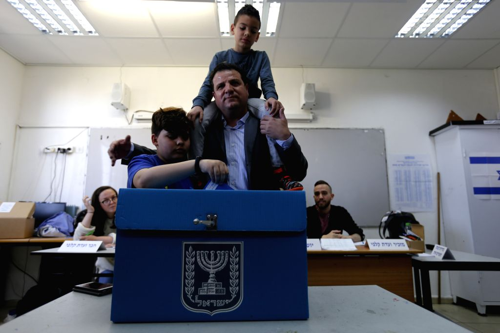 HAIFA, April 9, 2019 - A man casts his ballot with his children at a polling station in Haifa, Israel, on April 9, 2019. Israel on Tuesday morning started day-long general elections to choose its ...