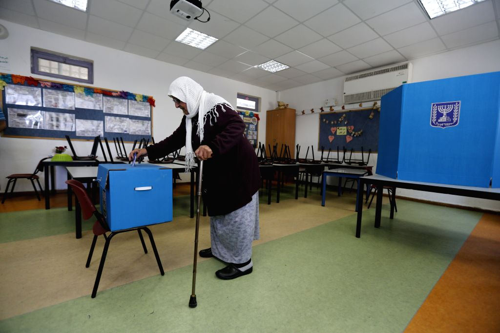 HAIFA, April 9, 2019 - A woman casts her ballot at a polling station in Haifa, Israel, on April 9, 2019. Israel on Tuesday morning started day-long general elections to choose its next parliament and ...