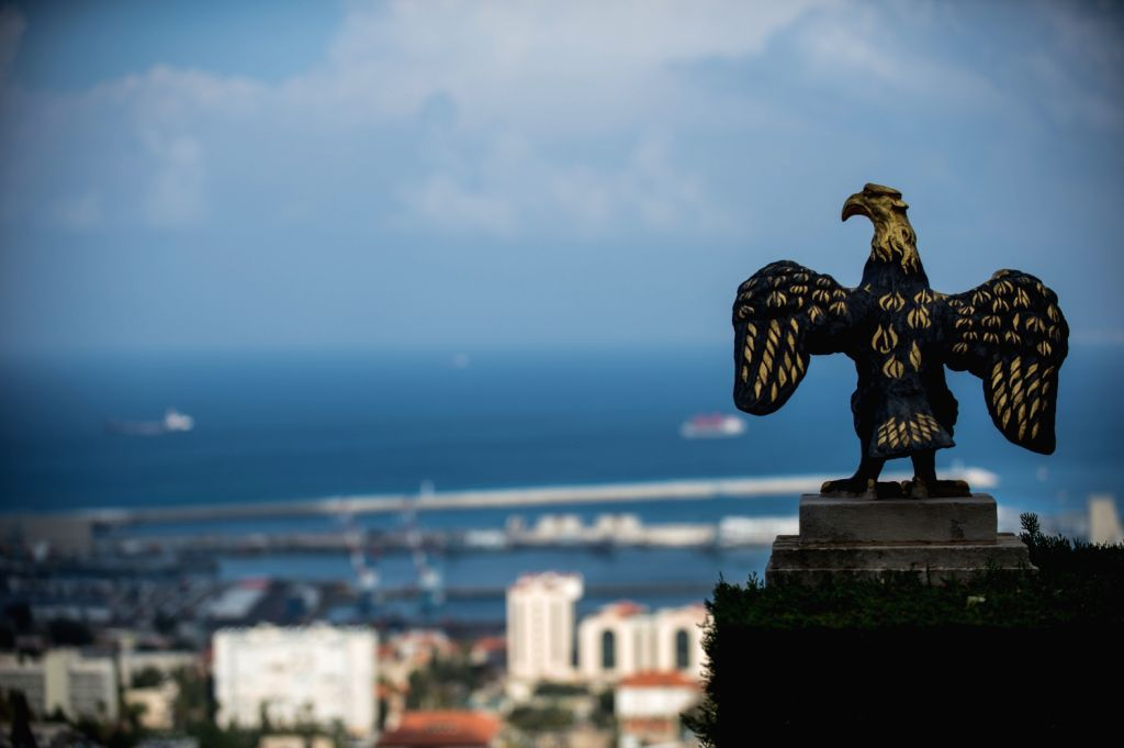 HAIFA (ISRAEL), Dec. 7, 2013 (Xinhua/IANS)Photo taken on Dec. 4, 2013, shows an eagle-shaped metal ornament at a garden in front the Shrine of the Bab in Haifa, Israel. The Baha'i Holy ...