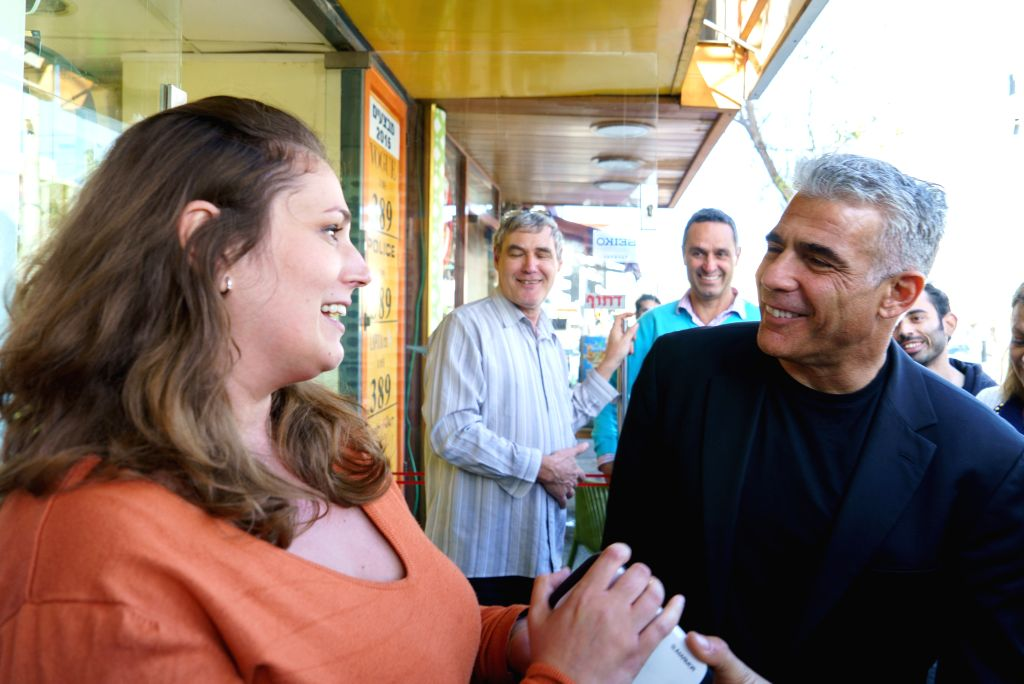 """HAIFA (ISRAEL), March 16, 2015 Yair Lapid (1st R, front), Israel's """"Yesh Atid"""" Party leader and former Finance Minister, talks to a local resident during an elections campaign ..."""