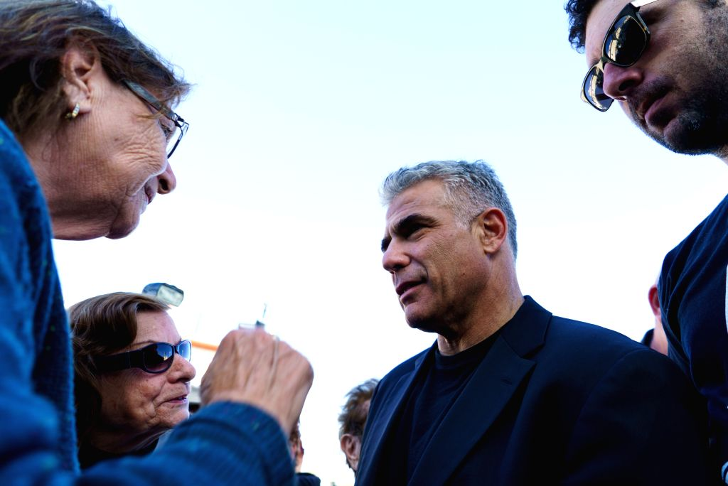 """HAIFA (ISRAEL), March 16, 2015 Yair Lapid (2nd R), Israel's """"Yesh Atid"""" Party leader and former Finance Minister, talks to local residents during an elections campaign tour in ..."""