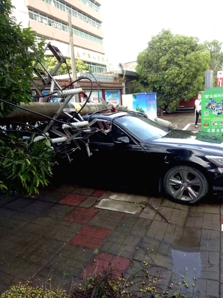 HAIKOU, Aug. 29, 2019 - A car is crushed by a utility pole after a tornado ripped across Nada Township of Danzhou City, south China's Hainan Province, Aug. 29, 2019. At least eight people died and ...