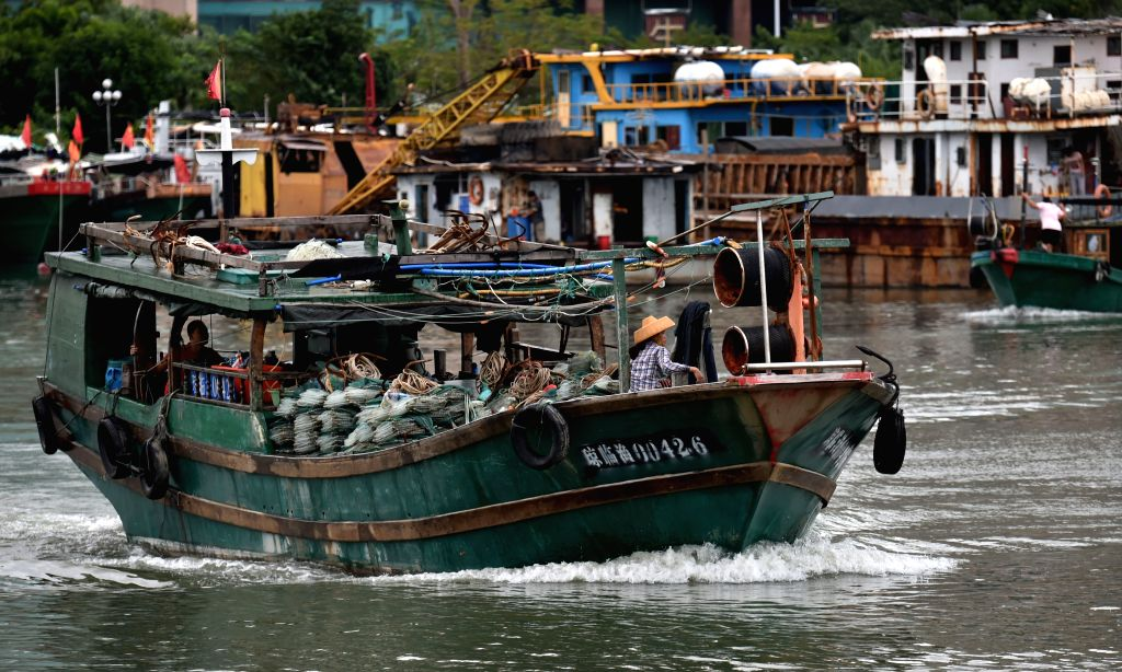 HAIKOU, Oct. 19, 2016 - A fishing boat leaves a shelter harbor in Haikou, capital of south china's Hainan Province, Oct. 19, 2016. Local meteorological bureau of Hainan has removed the third level ...