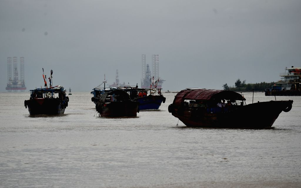 HAIKOU, Oct. 19, 2016 - Fishing boats leave a shelter harbor after typhoon Sarika in Haikou, capital of south china's Hainan Province, Oct. 19, 2016.  Local meteorological bureau of Hainan has ...