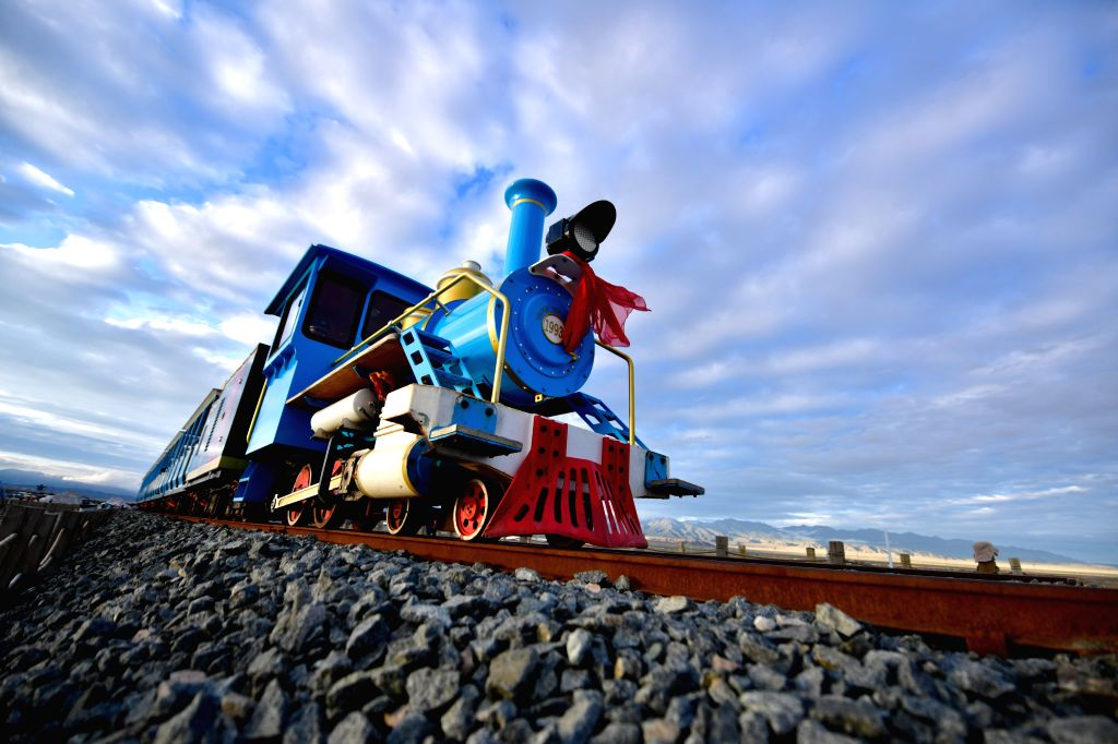 HAIXI, July 19, 2019 - A tourist train runs in the Caka Salt Lake scenic spot at Caka Town of Wulan County, northwest China's Qinghai Province, July 18, 2019. Caka Salt Lake, covering an area of 105 ...