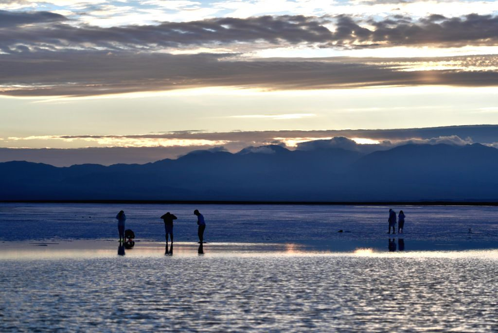 HAIXI, July 19, 2019 - Tourists visit the Caka Salt Lake scenic spot at Caka Town of Wulan County, northwest China's Qinghai Province, July 18, 2019. Caka Salt Lake, covering an area of 105 square ...