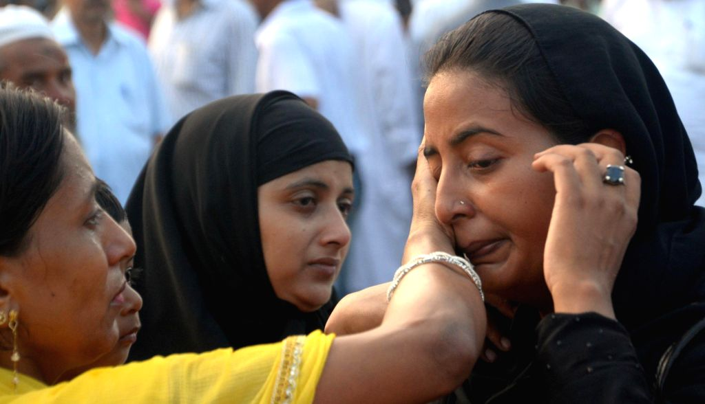 Haj pilgrims share emotional moments with their relatives ahead of leaving for Mecca at Haj House in Lucknow on Aug 27, 2014.