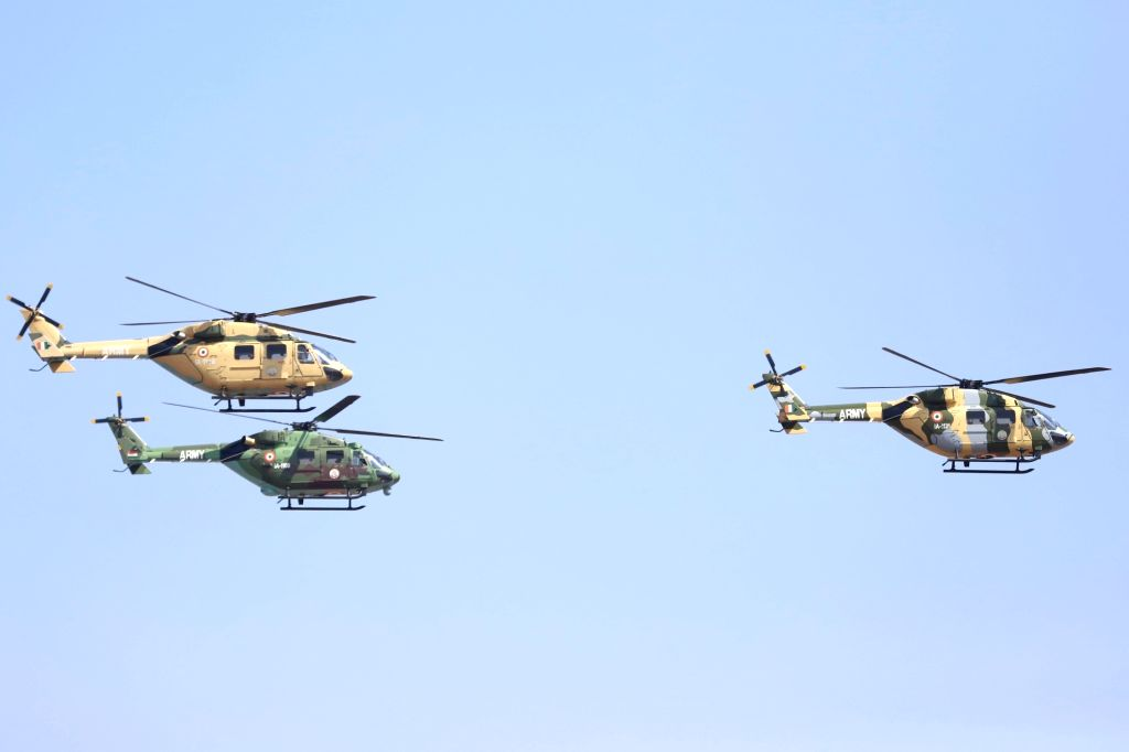 """HAL Dhruv Advance Light Helicopter perform during the inauguration of the """"Aero India 2019"""" - air show at Yelahanka Air Force Station, in Bengaluru, on Feb 20, 2019."""