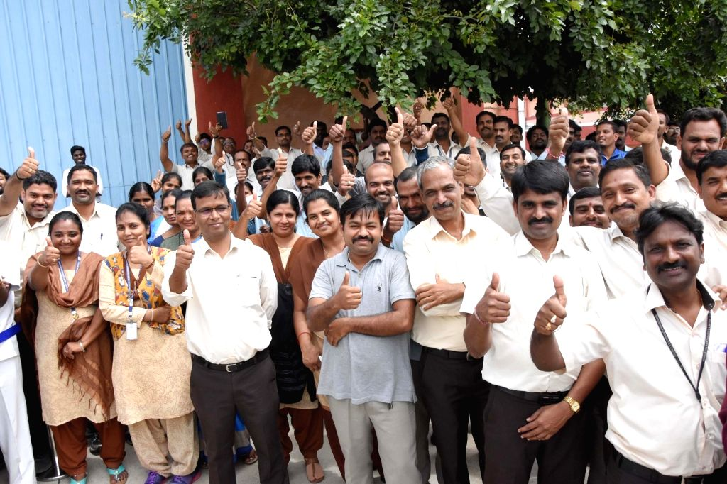 HAL employees flash a thumbs-up during Defence Minister Rajnath Singh's maiden sortie on a Tejas Light Combat Aircraft (LCA) at the HAL Airport in Bengaluru, on Sep 19, 2019. (Photo: IANS) - Rajnath Singh