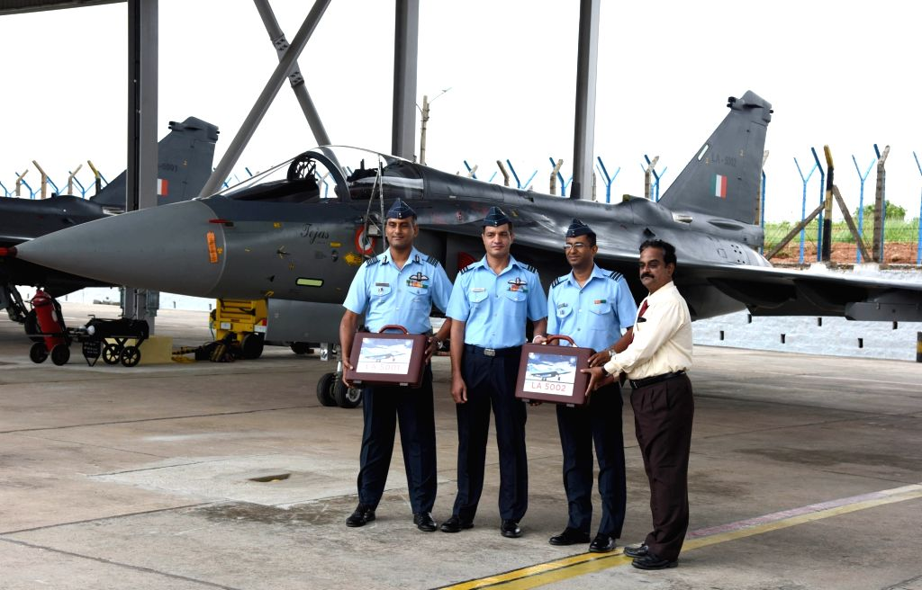 HAL officials handover light combat aircraft (LCA) 'Tejas' to Indian Air Force during its induction ceremony at HAL, in Bengaluru on July 1, 2016.