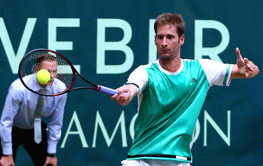 HALLE, Jun. 24, 2017 - Florian Mayer of Germany returns the ball during the men's singles quarterfinal match against Roger Federer of Switzerland in the Gerry Weber Open 2017 in Halle, Germany, on ...