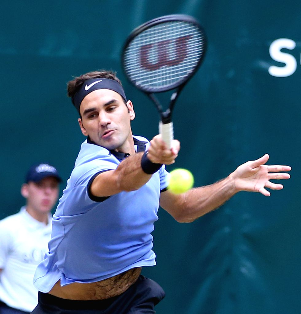 HALLE, June 25, 2017 - Roger Federer from Switzerland returns the ball during his final match against Alexander Zverev from Germany at the Gerry Weber Open tennis tournament in Halle, western ...