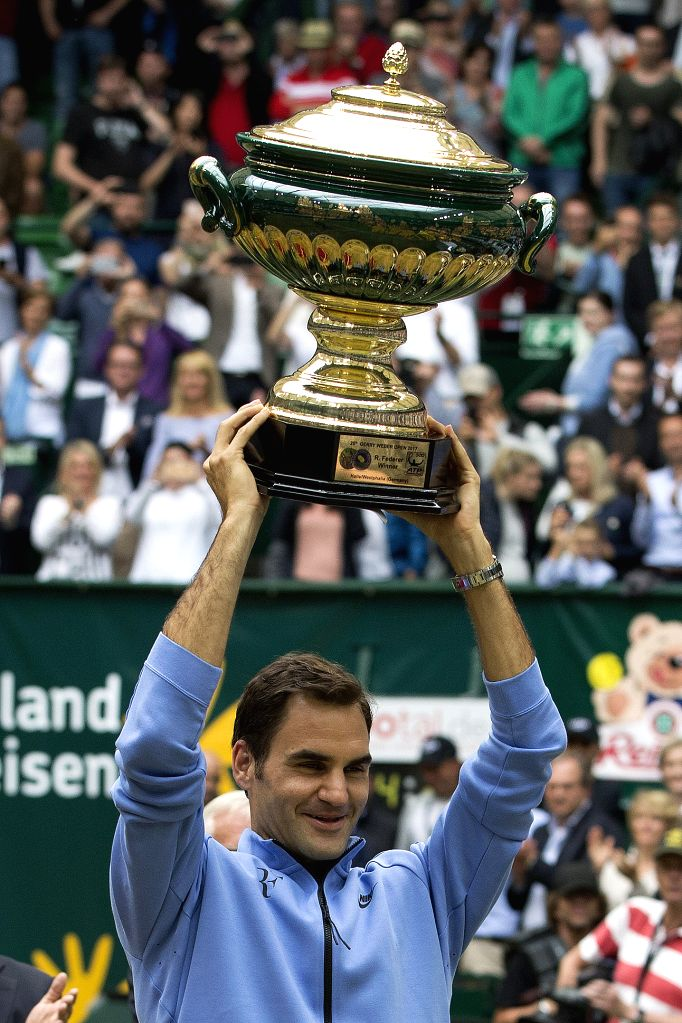 HALLE, June 25, 2017 - Roger Federer from Switzerland poses with his trophy after winning his final match against Alexander Zverev from Germany at the Gerry Weber Open tennis tournament in Halle, ...