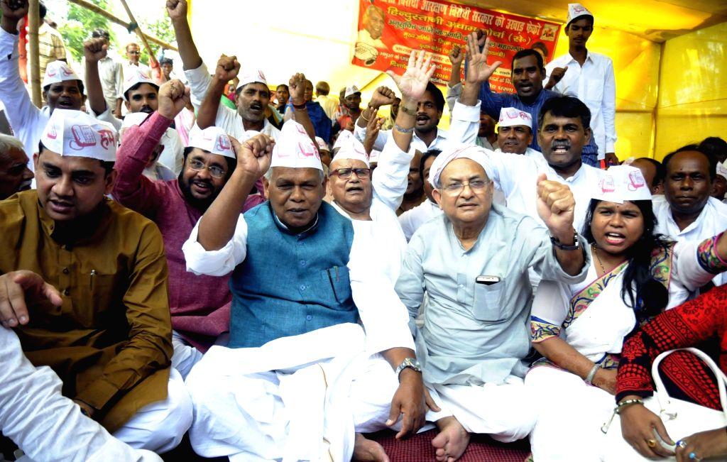 HAM leader Jitan Ram Manjhi leads a demonstration against Bihar government in Patna on Aug 5. 2016.