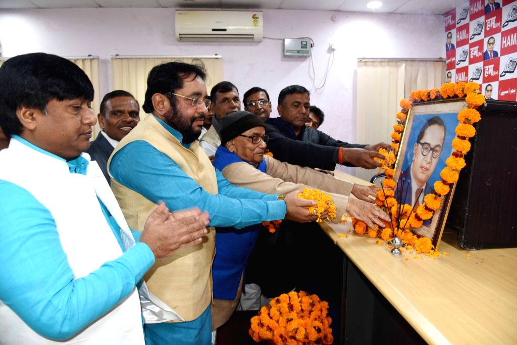 HAM-S leaders pay tributes to Dr B.R. Ambedkar on his 64th death anniversary commemorated as Mahaparinirvan Diwas, in Patna on Dec 6, 2019.