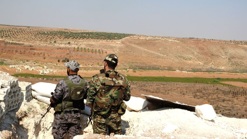 HAMA, Aug. 3, 2019 - Syrian military personnel observe the situation in the northern countryside of the central province of Hama, Syria, Aug. 2, 2019. The cease-fire that went into force on Thursday ...