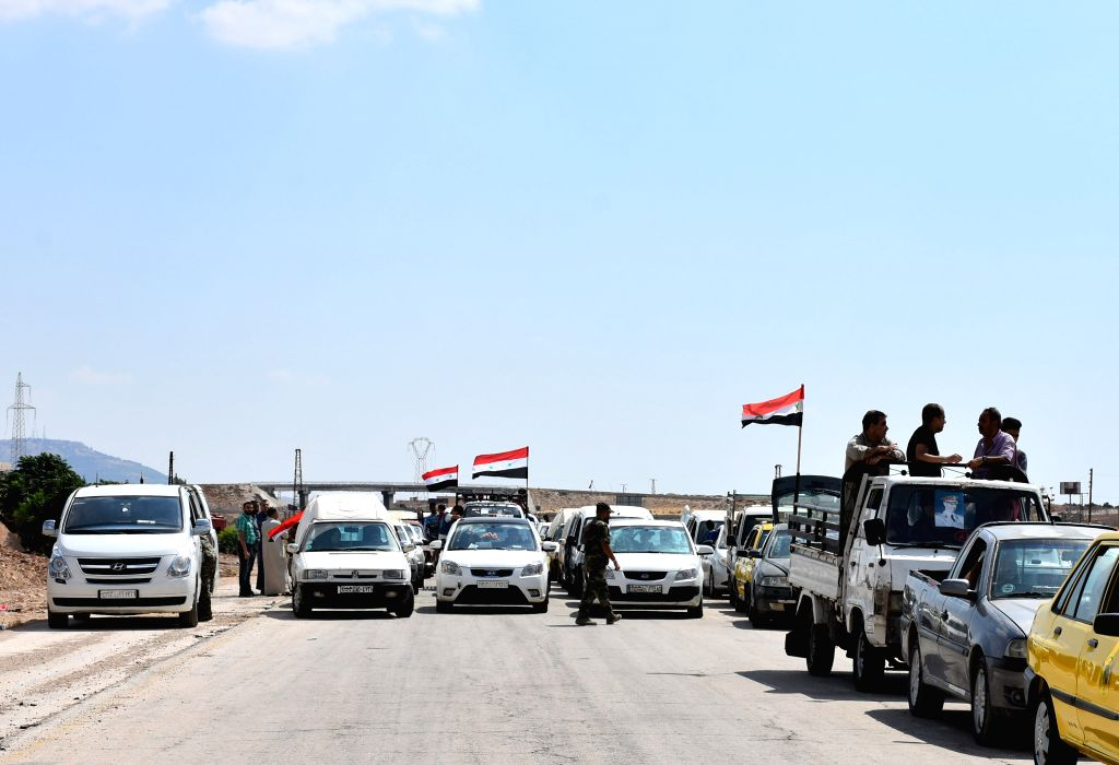 HAMA, Sept. 15, 2019 - Vehicles transporting displaced Syrians arrive at the Souran crossing in the northern countryside of Hama province, Syria, on Sept. 15, 2019. Thousands of civilians returned to ...