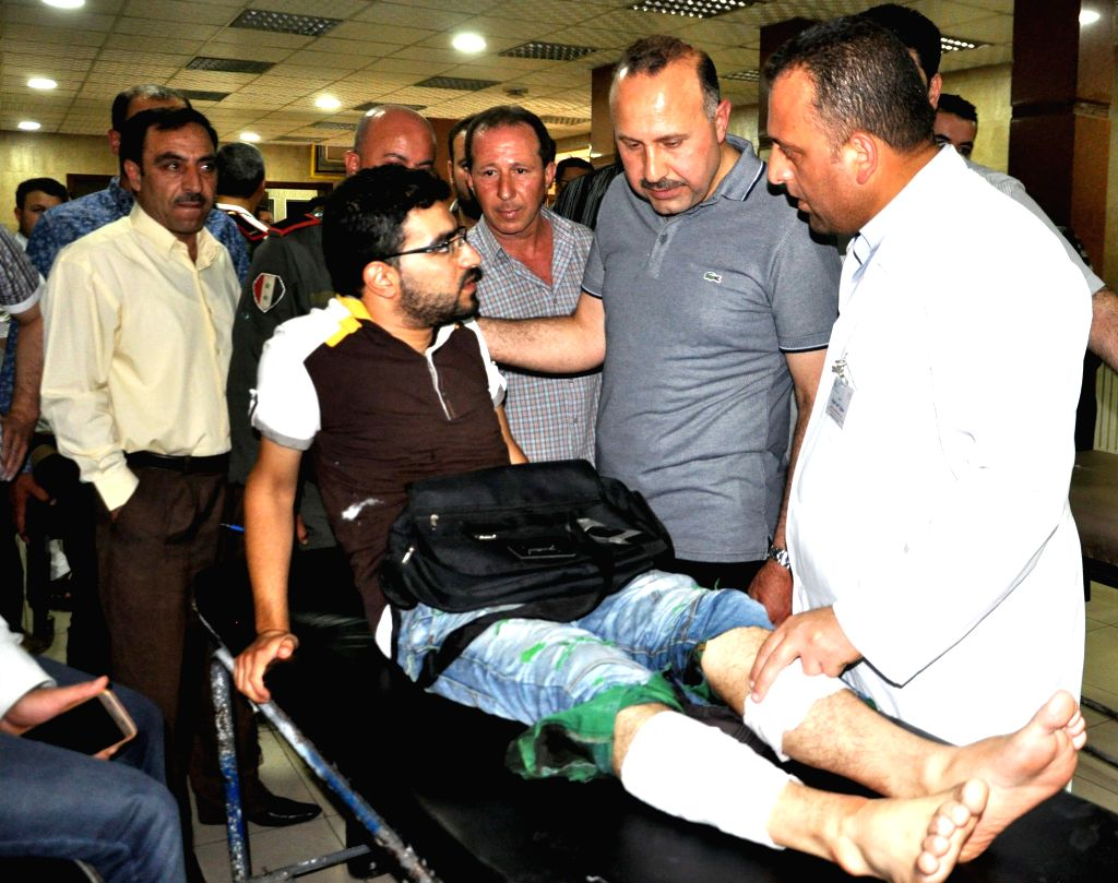 HAMA (SYRIA), July 6, 2017 A wounded man sits on a hospital stretcher in Hama, Syria, on July 6, 2017. At least three people were killed and nine others wounded on Thursday when a suicide ...