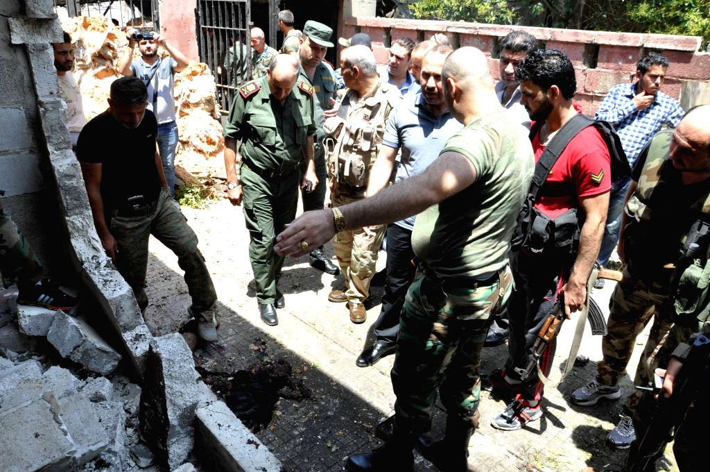 HAMA (SYRIA), July 6, 2017 Syrian soldiers check the site of the bomb attack in Hama, Syria, on July 6, 2017. At least three people were killed and nine others wounded on Thursday when a ...