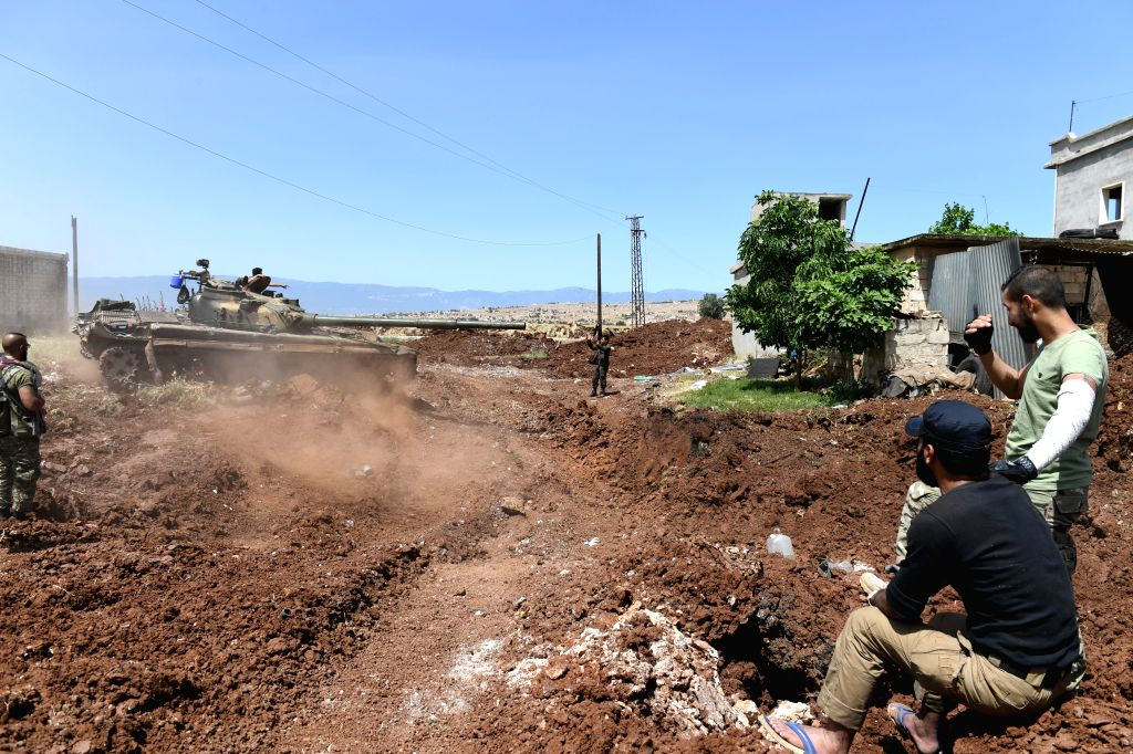 HAMA (SYRIA), May 25, 2019 Fighters from Syrian army are seen in a military operation against the rebels of the Nusra Front in the northern countryside of Hama province, central Syria, on ...