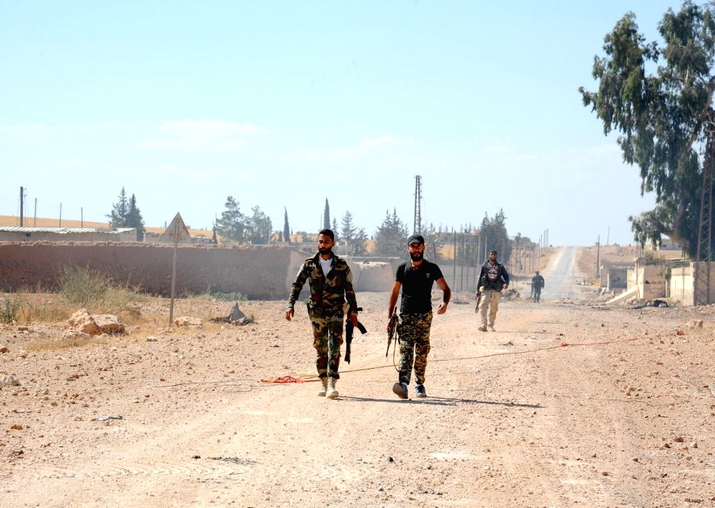 HAMA (SYRIA), Oct. 3, 2017 Syrian soldiers walk in a recently captured town in Hama, Syria, on Oct. 3, 2017. The Syrian army succeeded on Tuesday to slice through an enclave controlled by ...