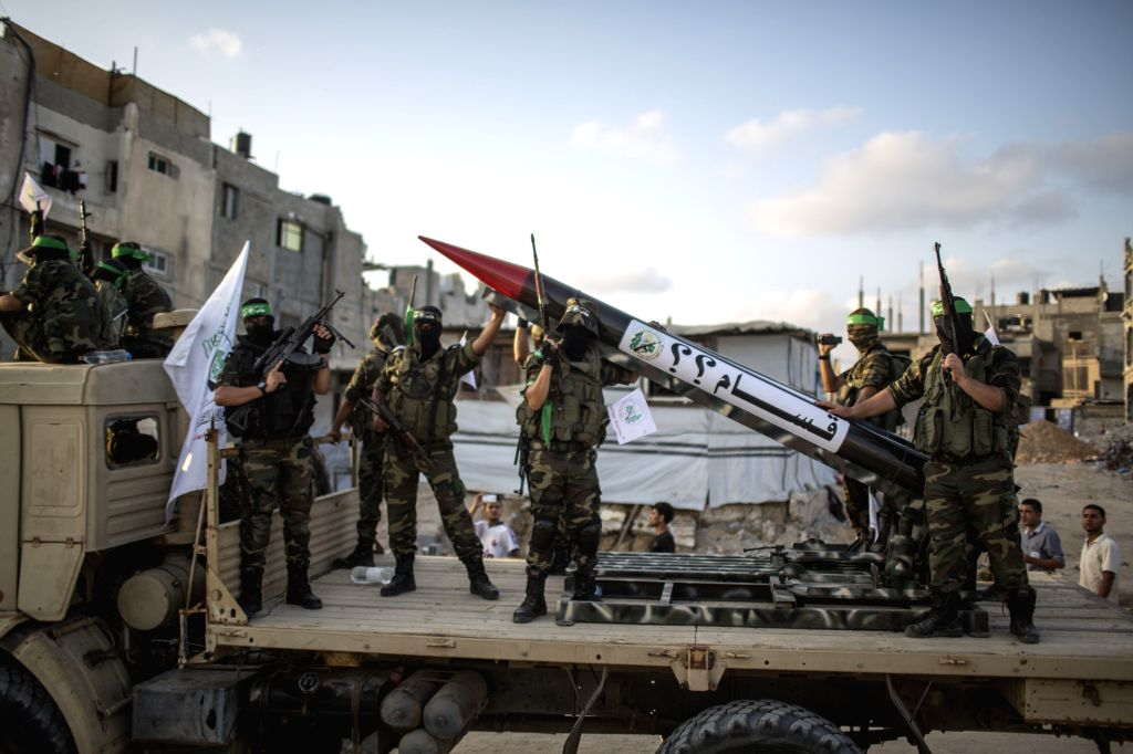 Hamas militants hold their weapons as they take part in a military parade in the northern Gaza Strip town of Beit Hanoun on Aug. 11, 2015.