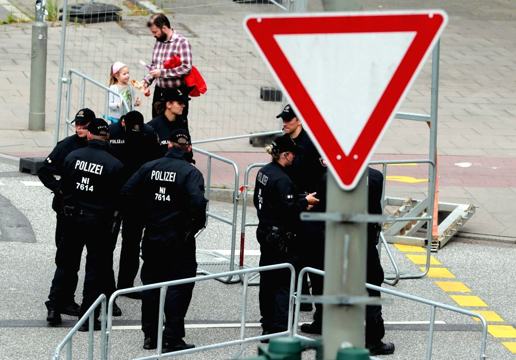 HAMBURG (GERMANY), July 5, 2017 Police officers stand guard near the Hamburg Messe in Hamburg, Germany, on July 5, 2017. The German armed forces (Bundeswehr) have issued a warning for all ...