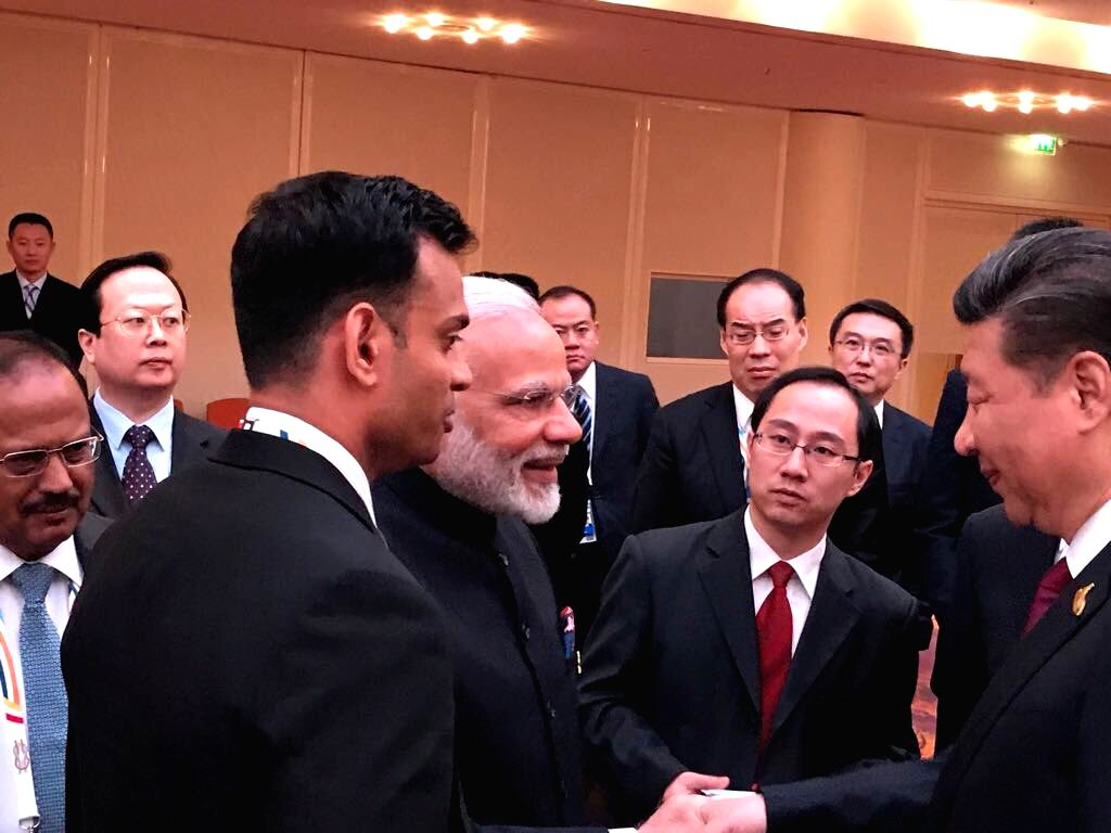 Hamburg (Germany): Prime Minister Narendra Modi and Chinese President Xi Jinping greet each other on the sidelines of the 12th G-20 Summit, at Hamburg, Germany on July 7, 2017. - Narendra Modi