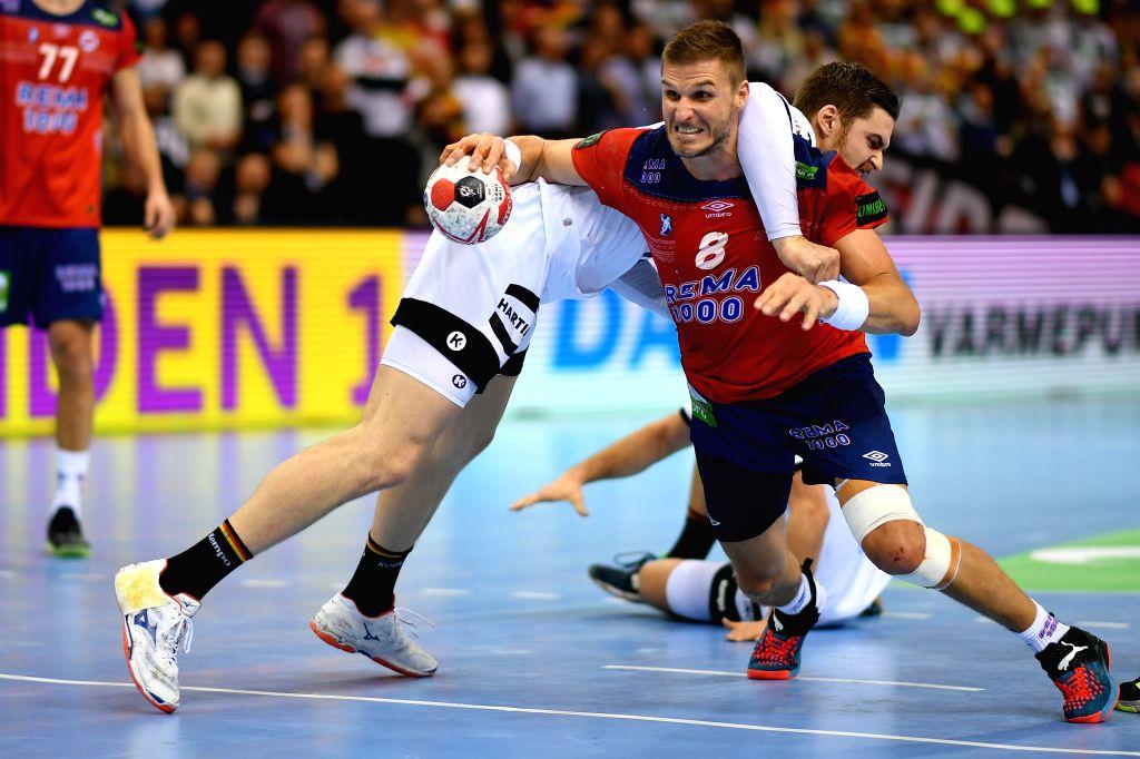 HAMBURG, Jan. 26, 2019 - Hendrik Pekeler of Germany (L) vies with Bjarte Myrhol of Norway during the IHF Men's Handball World Championship semifinals between Germany and Norway in Hamburg, Germany, ...