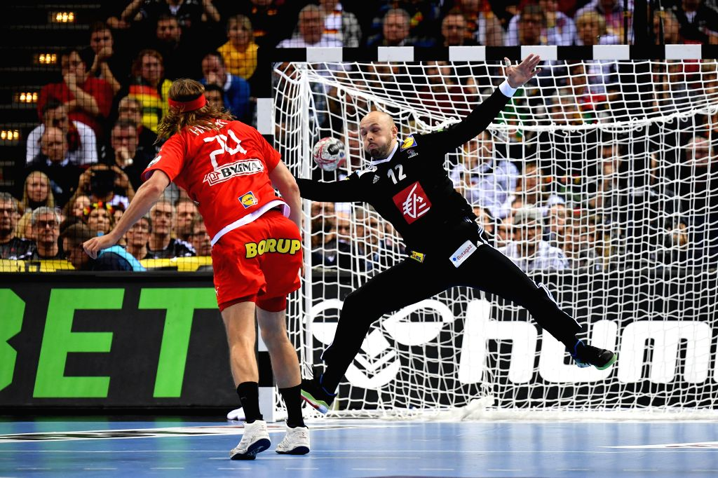HAMBURG, Jan. 26, 2019 - Mikkel Hansen (L) of Denmark shoots during the IHF Men's Handball World Championship semifinals between Denmark and France in Hamburg, Germany, on Jan. 25, 2019. Denmark won ...