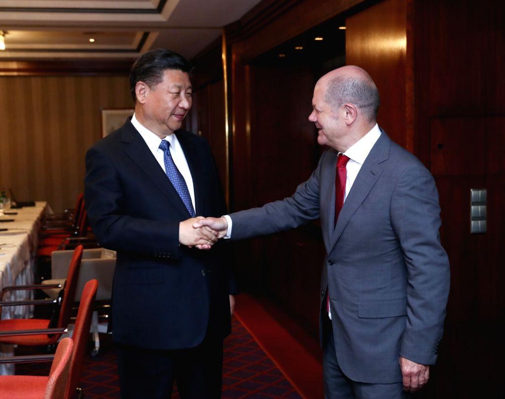 HAMBURG, July 6, 2017 - Chinese President Xi Jinping (L) meets with Hamburg's mayor Olaf Scholz in Hamburg, Germany, July 6, 2017.