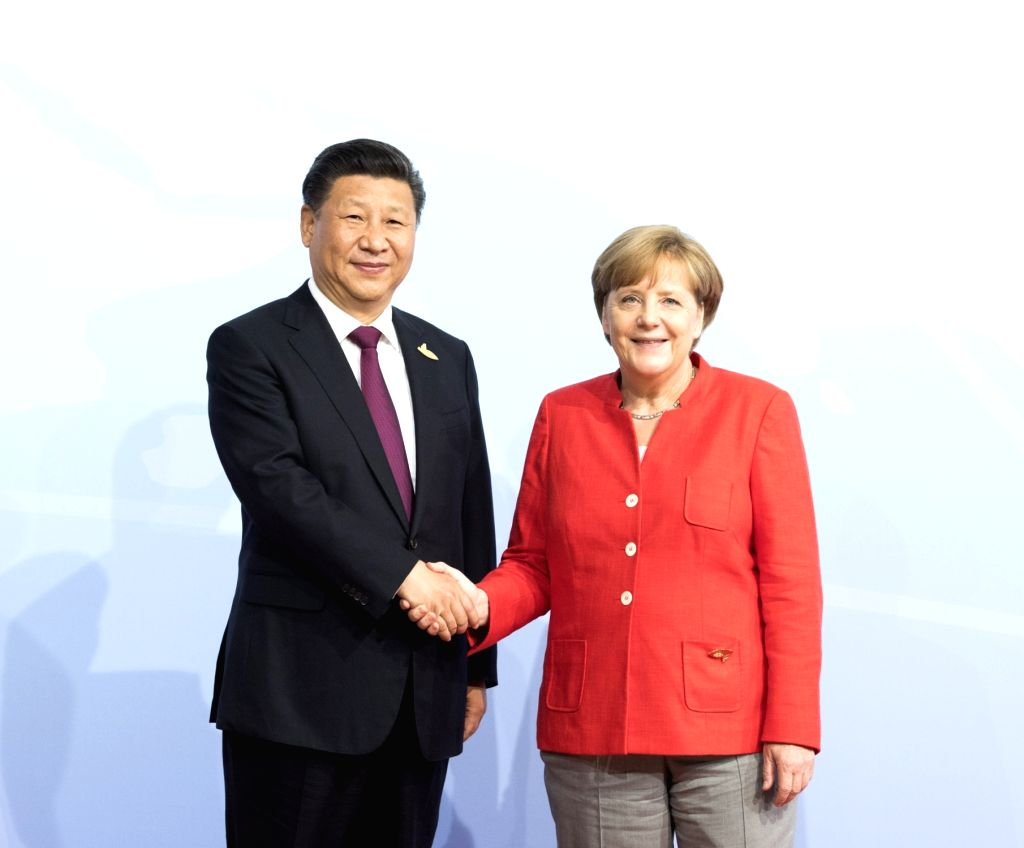 HAMBURG, July 7, 2017 - Chinese President Xi Jinping (L) is greeted by German Chancellor Angela Merkel before the 12th Summit of the Group of 20 (G20) major economies in Hamburg, Germany, July 7, ...
