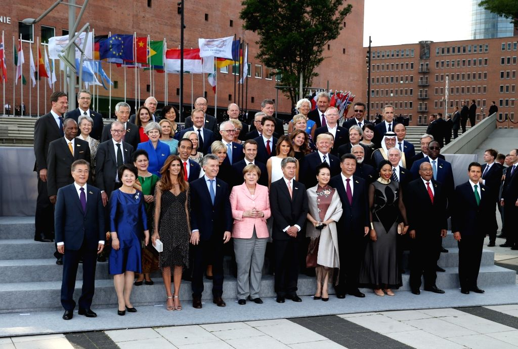 HAMBURG, July 7, 2017 - ers attending the Group of 20 summit and their spouses pose for a group photo in Hamburg, Germany, July 7, 2017. The 12th Summit of the Group of 20 (G20) major economies ...