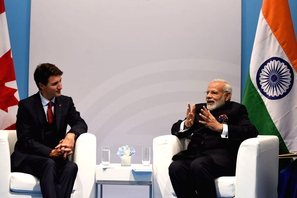 Hamburg: Prime Minister Narendra Modi meets Canadian Premier Justin Trudeau on the sidelines of the G20 Summit at Hamburg, Germany on July 7, 2017. (Photo: IANS/MEA) - Narendra Modi