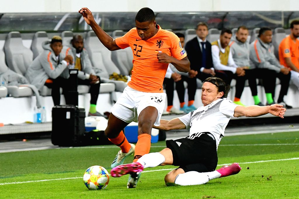 HAMBURG, Sept. 7, 2019 - Nico Schulz (R) of Germany vies with Denzel Dumfries of the Netherlands during the UEFA Euro 2020 Group C qualifying football match between Germany and the Netherlands in ...