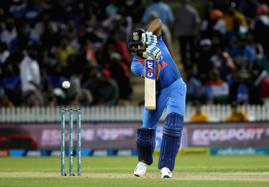 Hamilton: India's Rohit Sharma in action during the third T20I match between India and New Zealand at Seddon Park in Hamilton, New Zealand on Feb 10, 2019. (Photo: Surjeet Yadav/IANS) - Rohit Sharma and Surjeet Yadav