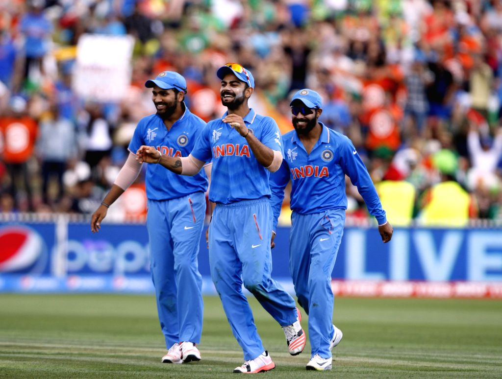 Hamilton (New Zealand):Indian cricketers celebrate fall of a wicket during an ICC World Cup - 2015 match against Ireland at the Seddon Park in Hamilton, New Zealand  on March 10, 2015.
