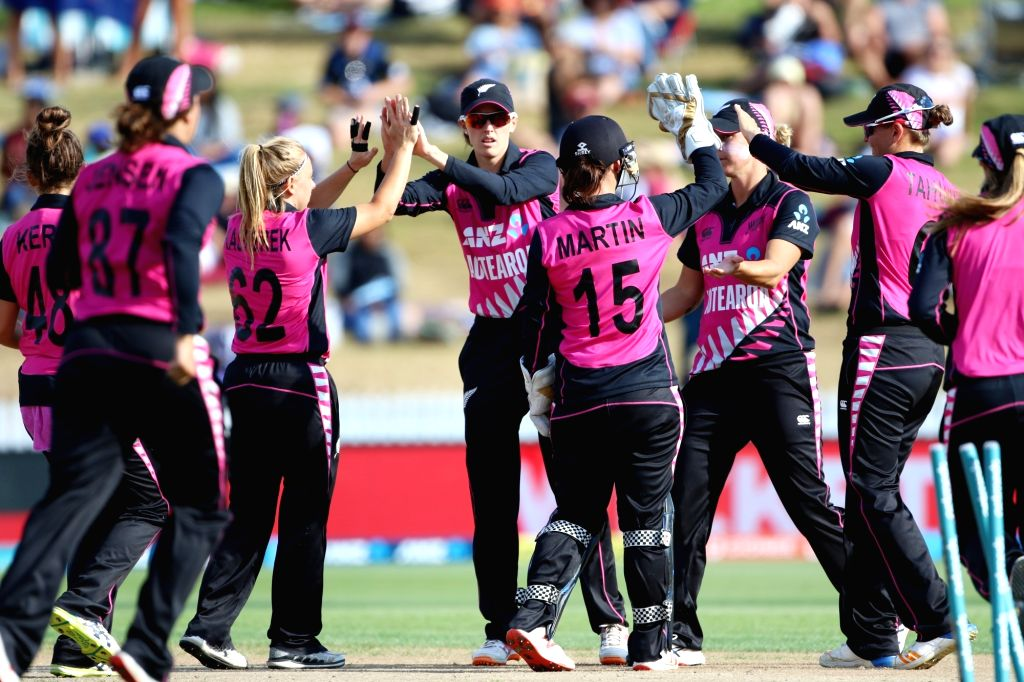 Hamilton (New Zealand): New Zealand players celebrate fall of a wicket during the third women's T20I match between India and New Zealand at Seddon Park in Hamilton, New Zealand on Feb 10, 2019.
